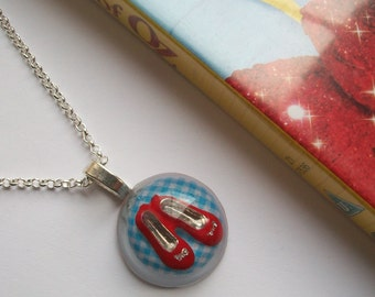 Dorothy - Wizard of Oz inspired resin necklace with ruby slippers. Pendant with shoes and gingham backdrop.