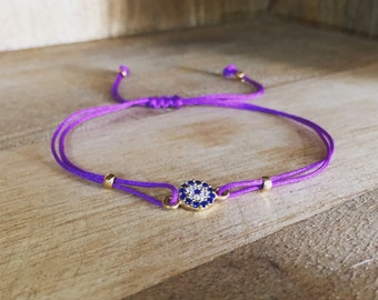 Purple string Bracelet with evil eye