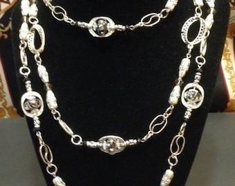 Unique Design, extra long beaded necklace.