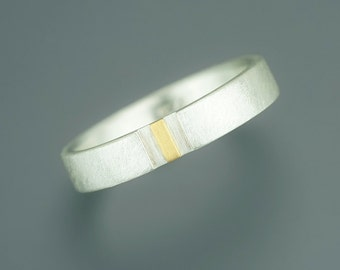 Silver ring with fine gold bar
