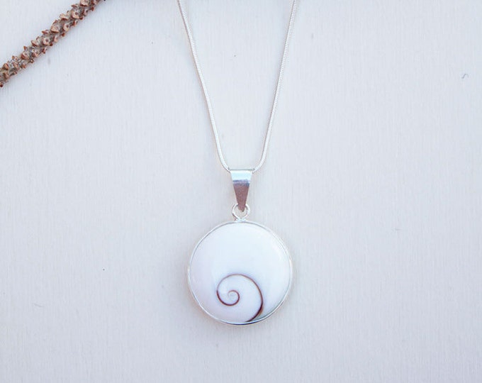 Sterling Silver necklace formed by Shiva Eye Shells