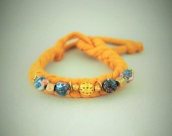 Braided strap mustard / recycled wool / Jasper blue-orange / gold metal