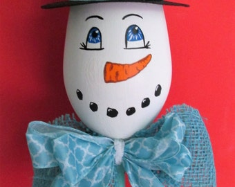 Hand-Painted Snowman Wine Glass shelf-sitter featuring a Top Hat and a Handmade Bow