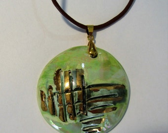 Cooking, handmade ceramic pendant, third fire with gold and mother of Pearl luster