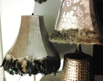 Fashion lamp shades in rich beige with feather trim and broquet with fur trim. Works of art