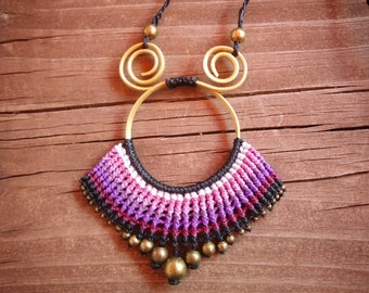 Pendant of bronze and macrame.