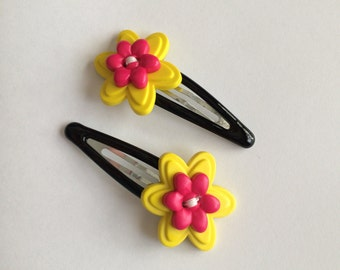 Yellow and pink flower button hair clip set