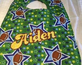 Aiden bib on footballs and stars