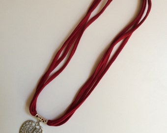 Red fabric with leaf pendant necklace