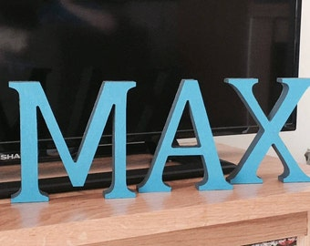 Hand Painted, Free-Standing Wooden Letters.