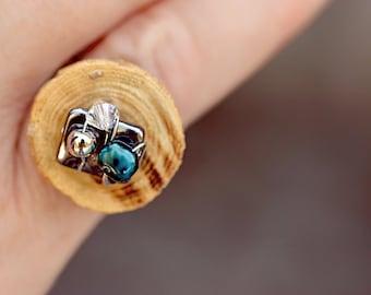 Ring single woman, wood, metal.