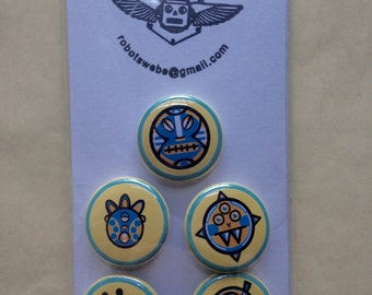 A set of (5) 1 inch Buggy Boy Monster buttons