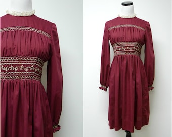 CAMILLA . long sleeves . hand smocked . burgundy dress . fits a small