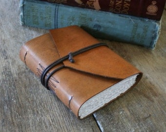 """Leather Journal - """"It's never too late to be what you might have been"""" -George Eliot . handmade handbound . hand-dyed rusty brown (320pgs)"""
