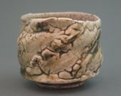 RESERVE FOR JEANINE Teacup, wood-fired iron rich stoneware with crawling shino, tenmoku and natural ash glazes