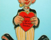 Vintage Unused Valentine's Day Card Rare Rocking Card Hobo with Dart in Neck Germany