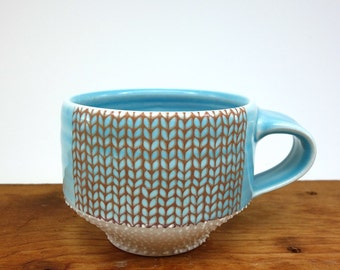 Blue glazed porcelain mug with knit pattern and dotted texture