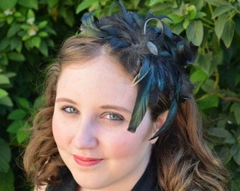 Natural teal and black iridescent feather plume fascinator on a headband
