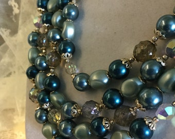 Stunning Four Strand Lucite Bead Necklace Teal Blue Smoke and Clear Beads Goldtone Findings