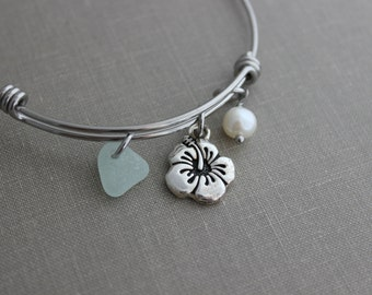 stainless steel adjustable beach bangle bracelet with pewter hibiscus flower charm, genuine sea glass and freshwater pearl Hawaiian jewelry