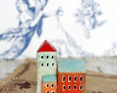 A small statue of a wooden town. Wooden miniature houses. Little wooden houses. Doll house miniatures. Rustic wooden houses.