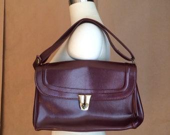 vintage 1970's purse / wine color vinyl handbag / top handle / embellished latch closure / mod retro style
