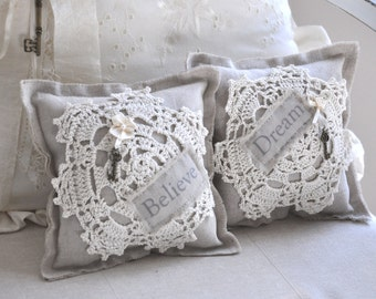 Two small crochet doily linen pillows
