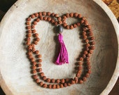 Raspberry Handmade Tassel, Lotus Seed & Rudraksha Mala Beads.