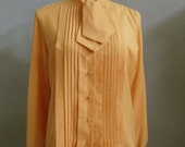 "Vintage 60's Southern Lady Long Sleeved Pumpkin Colored Blouse with a Collar That Extends Out to 2 Ties Bust 42"" Waist 40"""