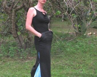 long black skirt with pockets, flowing shibori panels, low bustle tucks. Linen