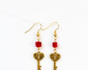Gold Toned Skeleton Key Earrings with Red Cube Crystal Beads