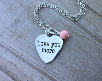 """Inspiration Necklace- """"Love you more"""" laser etched charm with an accent bead in your choice of colors"""