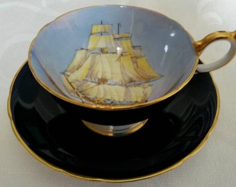Aynsley Tea Cup and Saucer; Cobalt Blue; Featuring A Clipper Ship; Hand Painted And Signed By D Jones  circa 1930's-  DR