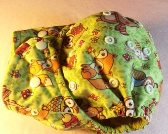 SassyCloth one size pocket cloth diaper with friendly forest pals PUL print. Made to order.