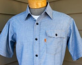 vintage 70's-80's -Levi's- short sleeve shirt. 'Orange' tab - Blue chambray. Like 'NeW'. Medium - Large