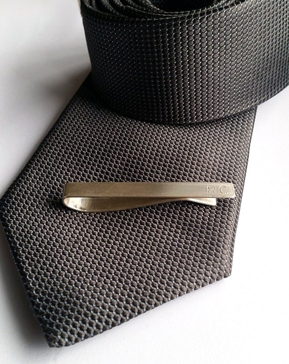 monogram tie bar from sterling silver of the groom