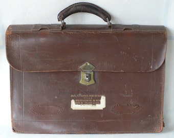 Vintage briefcase, brown leather,Government issue, period movie, from Diz Has Neat Stuff