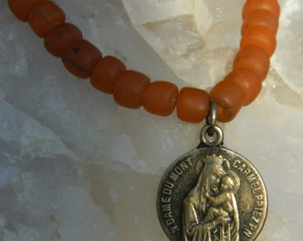 LADY MT. CARMEL vintage repurposed assemblage bracelet handmade stretch jewelry Mary Lourdes catholic orange glass bead atelier paris etsy