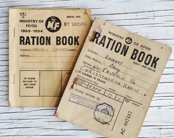 Collection of two vintage British ration books, 1943 & 1953. 14 pages including cover pages. Collectable ephemera.