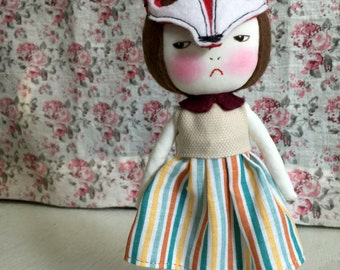 Handmade grumpy doll wearing fox mask