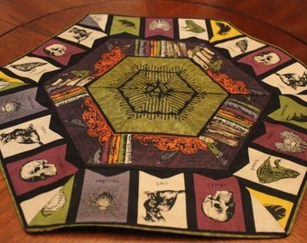 Halloween Quilted Hexagon Table Topper with Reversible Print: Bookshelf/Banner and Dark Night Pumpkins