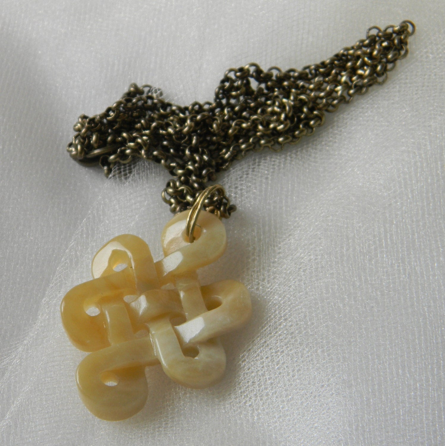 infinity knot pendant w antiqued brass chain necklace beaded