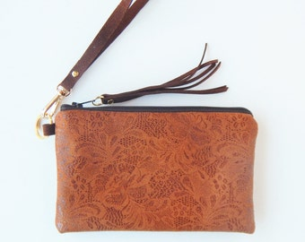 Lacey leather wristlet or clutch, brown leather wristlet with lace imprint.