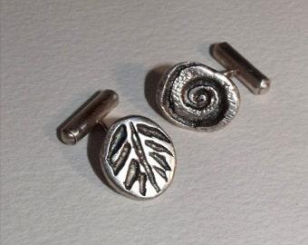 Silver 'Fossil' cufflinks.