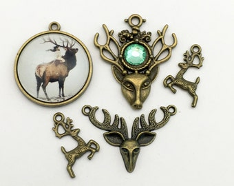 5 elk charms and glass pendant