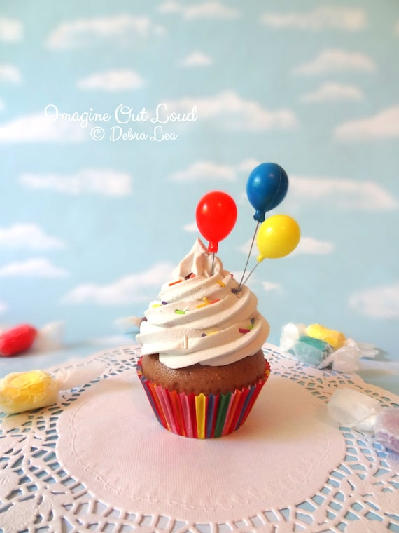 Fake Cupcake Chocolate Primary Colors Frosting and Party Balloons