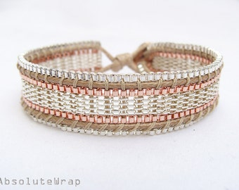 Single wrap bracelet with copper plated and silver plated chain on soft polyester cord