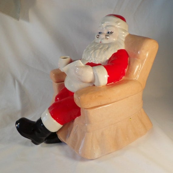 Cookie jar santa claus on the couch reading his list