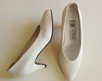 80s white almond toe pumps with kitten heels