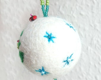 Felted ball with ornament for the Christmas tree or other decoration.